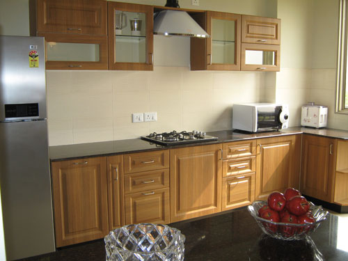 modular Kitchen with Vitrified tile and wooden flooring